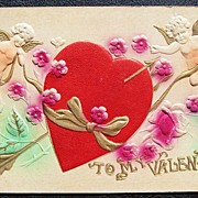 Early 1900s Deeply Embossed Gilded Airbrushed Postcard, Cupids Frolic around Captured Heart
