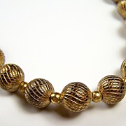 """Gold-Tone Swirl Textured Beaded 24"""" Necklace, 1960s-1970s"""