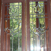 Pair of beveled stained glass sidelights with a tulip design