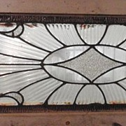 Long American transom window with clear and fluted glass