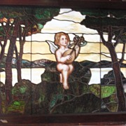 Nineteenth century stained glass window with cherub playing the mandolin