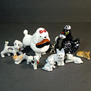 Assortment of 9 Ceramic 1950s Dimestore Dog Figurines