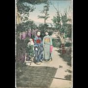 2 Japanese Ladies in Kimono in a Garden. Vintage postcard.