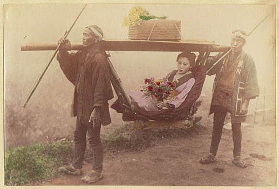 Mode of Transportation. Japanese Girl, carried by 2 Men. Tinted Albumen Photo. 1880s