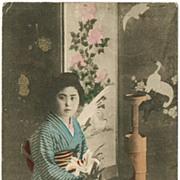 Japanese Lady in Kimono, doing Ikebana. Vintage postcard.