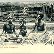 """Greetings from Singapore"". Men, offering  daggers. Vintage Postcard."