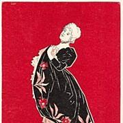 Ca. 1910: Lady in black robe. Decorative Art Nouveau Postcard