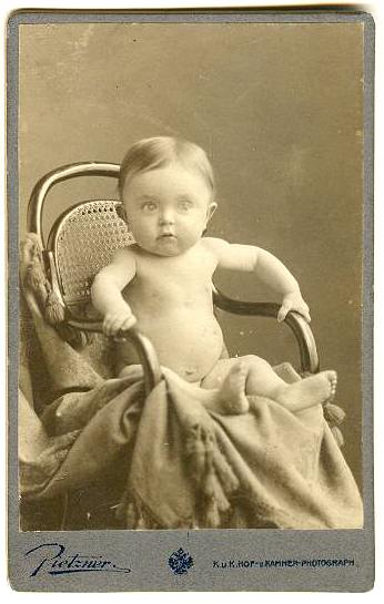 1916: Lovely cabinet Photo of a Baby on a chair.