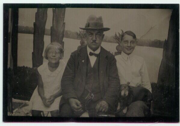 Older Gentleman with 2 Children an a Dog