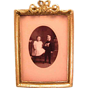 "Gilt Soft Metal Picture Frame with Photo of Boy and Girl 1"" Scale"