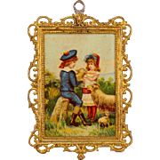 Antique German Dollhouse Gilt Soft Metal Picture Frame with Lithograph Print of Boy and Girl .