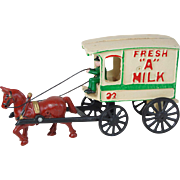 Vintage cast iron Fresh Grade A Milk  No. 32 wagon horse and driver