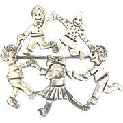 Signed Sterling Brooch with Children at Play