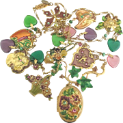 Gorgeous Whimsical Loaded Signed Enamel on Gold Tone Charm Necklace with Large Locket