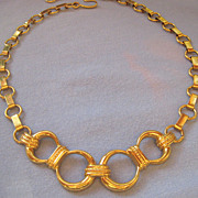 Interesting Monet Gold Tone Circle and Book Link Necklace