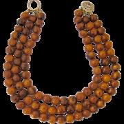 KJL Kenneth Jay Lane Triple Strand Bakelite Necklace Swirling Amber Color