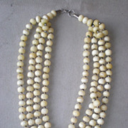 Wonderful Four Strand Bone Bead Necklace