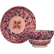 c1835 red and blue spatterware Staffordshire handleless cup and saucer