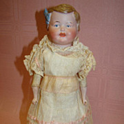 11 In. German Shoulder Head Child, Molded Hair and Bow