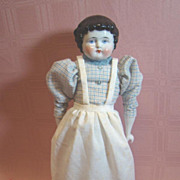 14-1/4 In. 1880's Black Hair China Shoulder Head with Bangs and Curls