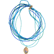 Ten Strand Beaded Necklace with Virgin Mary Picture Pendant