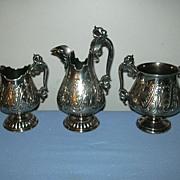 SOLD James W Tufts Silver Quadruple Plate 3Pc Creamer Syrup Set With Face Mythological & Winge