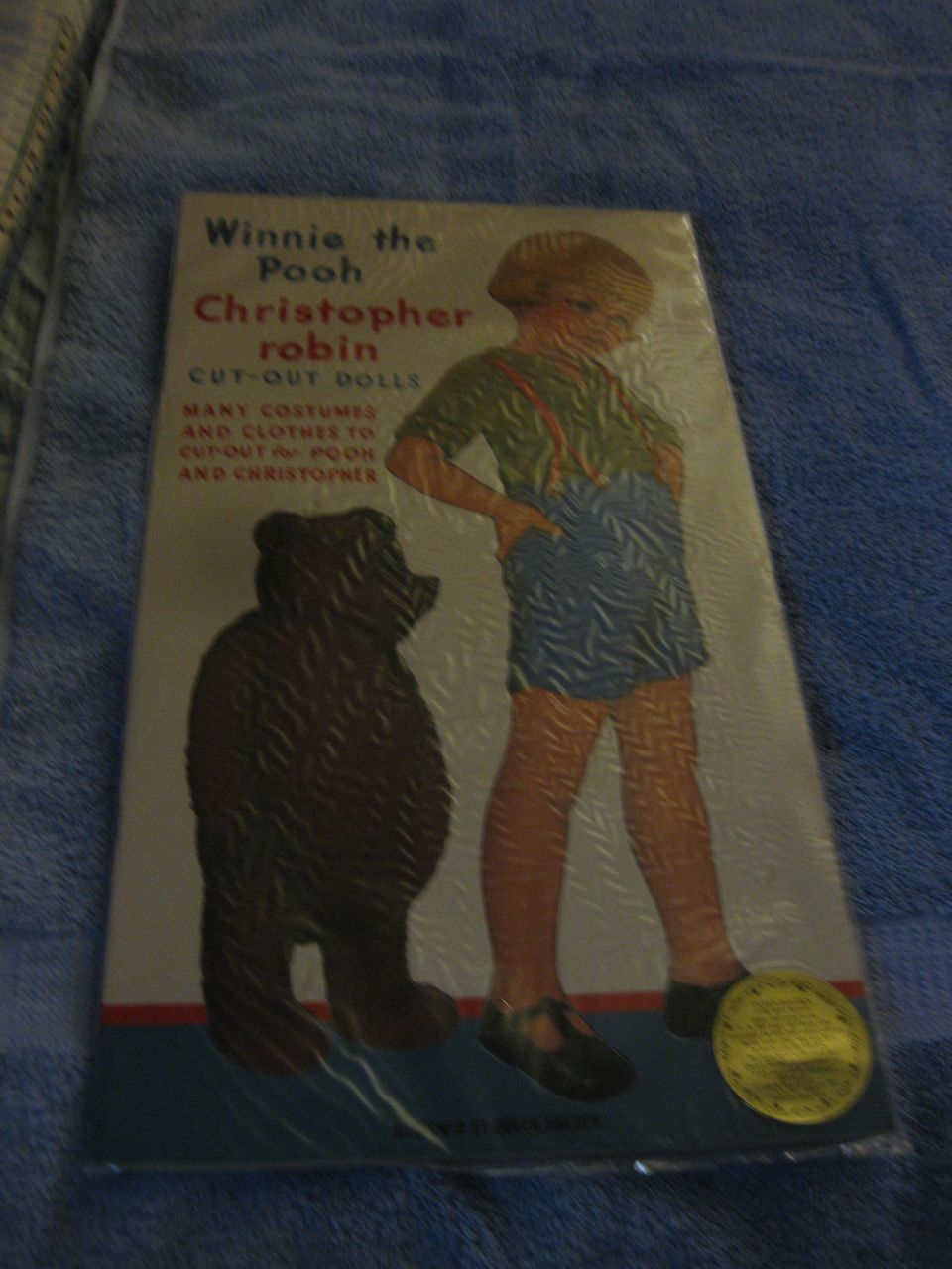 Winnie the Pooh Christopher  Robin cut-out dolls book  Many costumes and clothes to cut out for pooh and christopher