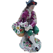 Sitzendorf Figurine of French Courtier with Basket of Flowers