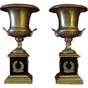 Pair of Brass Mantle Urns Mounted on Black Pedestal Bases