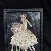 Framed Three-Dimensional Image of Young Woman in Fabric Created Dress & Bonnet