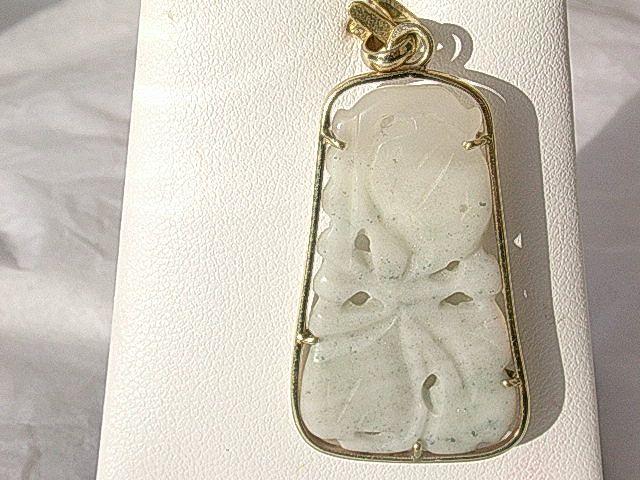 14kt Carved Floral Jade Pendant