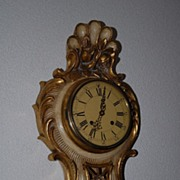 SALE A Carved Gilt Wooden Cartel Wall Clock