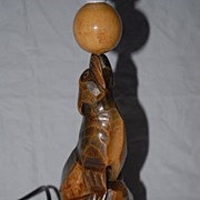 SALE A Fine Carved Wood Black Forest Seal Table Lamp