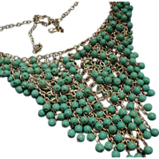 SALE VINTAGE 15 strand bib turquoise glass beads on a silver tone linked frame.
