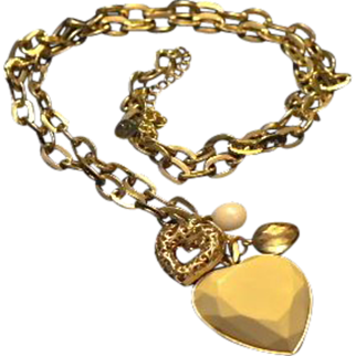 REDUCED VINTAGE necklace designed by CR  Cream Lucite puffy heart with smaller gold tone filigree one
