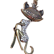 SALE VINTAGE A pendant necklace with a seductive bronze kitty kat laden with rhinestones