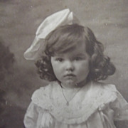 Little Girl With Big Bow and Bouquet