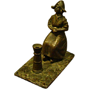 Bronze small sculpture of seated Dutch girl woman