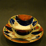 Miniature Gaudy Dutch or Welch cup and saucer