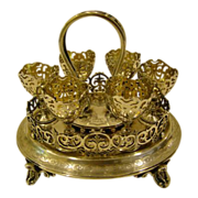 Ornate silverplate egg cup presentation carrier 1884