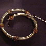 Vintage Coiling Stove Pipe Styled Necklace with Faux Amber Beads