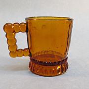 SOLD Amber Pressed Glass Child's Mug