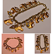 Brass and Copper Rhinestone Horse Charm Bracelet Loaded with Charms.