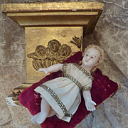 SOLD Adorable 19th C. French small wax baby Jesus : doll on velvet cushion tassels