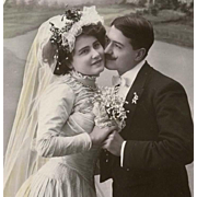 "Edwardian Bride French Postcard of Wedding Couple in Oval Inset ""First Kiss"""
