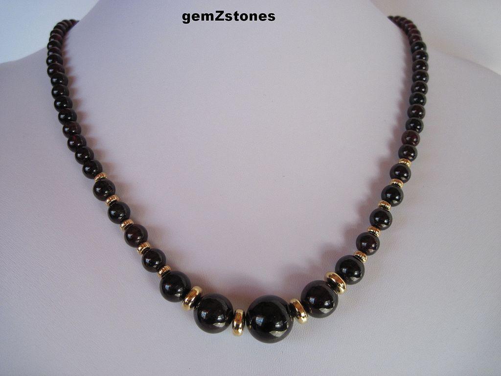 Elegant Garnet And Gold Single Strand Necklace