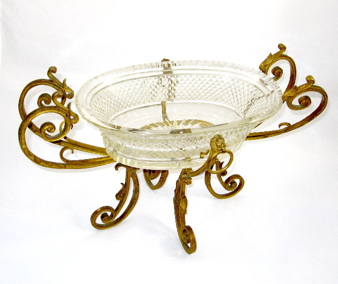A Napoleon III Cut Crystal Centerpiece with Dore bronze Mounts.