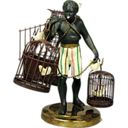 SOLD Vintage Bronze Black Americana Man w/ Bird Cages Figurine