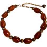 Bakelite bead necklace metal rose beads amber colored bakelite