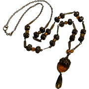1930's Sautoir necklace filigree brass beads amber glass intaglio cameo and beads
